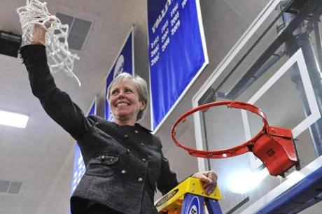 Coach Barbara Stevens cut down the net after leading her team to the Elite Eight.