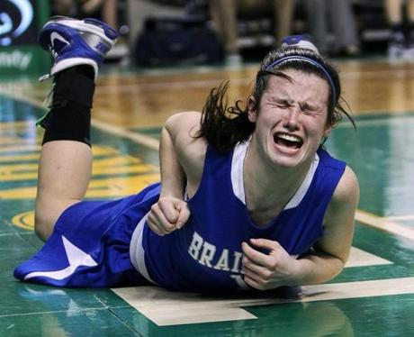 3-13-12 Boston, MA: Braintree's Rachel Norton is in pain after taking a tumble under the boards during second half rebounding action, but she was OK. Andover and Braintree met for the state Division One semi final in girl's basketball in the fourth of four games today held at the TD Garden. (Globe Staff Photo/Jim Davis) Section:sports Slug:Schools