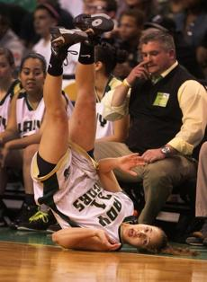 Alexandria Richards, a senior forward for Greater New Bedford, took a tumble in the Division 4 title game against Fenway at TD Garden, March 13, 2012.