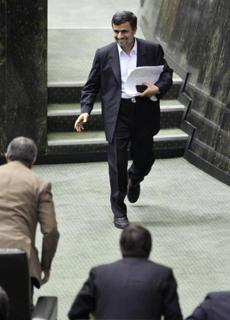 Ahmadinejad leaves the podium after answering parliament's questions in Tehran Wednesday.