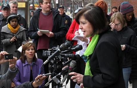US Attorney Carmen Ortiz spoke outside the courthouse.