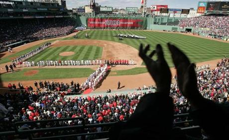 A packed house turned out on Opening Day to watch the Red Sox raise their first championship banner in 86 years.