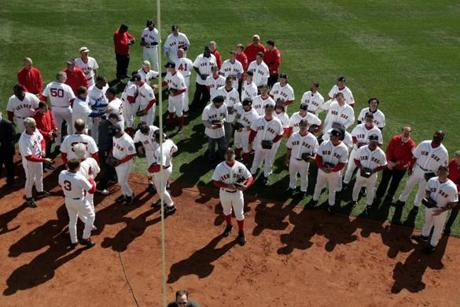 Red Sox players walked out to center field, where they hoisted the banner celebrating last year's World Series title.