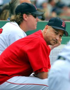 Terry Francona (front) and pitcher Curt Schilling were glum as they watched the sweep become finalized.