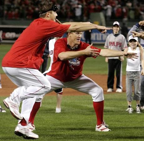 Jonathan Papelbon, left, and Mike Timlin danced on the field after the win.