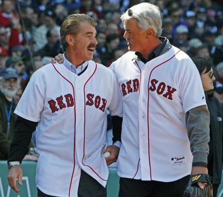 Former teammate Dwight Evans caught the ceremonial first pitch from Buckner.
