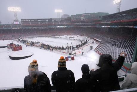 The day before the game, snow fell as the teams practiced at Fenway.