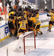 The Bruins piled on Sturm in celebration after his game-winning goal.