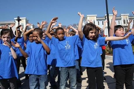 South Boston, MA., 03/20/12, The Homes at Old Colony had a ribbon cutting and grand opening ceremony today. Children from the Michael J. Perkins Elementary School performed songs for the crowd. Left to right, Chelsea Mulligan, Michael Ruemmeley, Ibrahim Bah, Lilah Gutlerner and Sofia Sai, all cq. Section: Metro, Reporter: Billy Baker Globe staff/Suzanne Kreiter