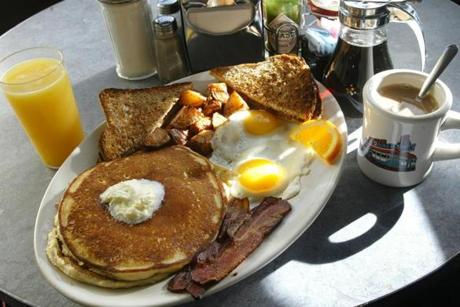 2/7/05--WATERTOWN --DELUXE TOWN DINER -- The Hungry Person's Breakfast, with pancakes, bacon, 2 eggs, wheat toast, homefries, OJ and coffee. Library Tag 02272005 Magazine