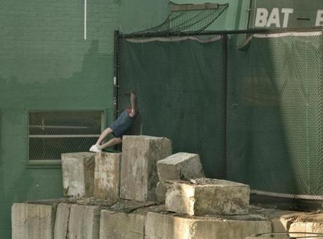 The Red Sox soon corrected the hole in the fence after fans used it to sneak into Fenway Park.