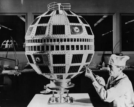 An engineer at work on a Project Telstar communication satellite at the Bell Telephone Laboratory.