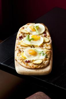 At B Street in Newton Centre, flatbread with eggs, bacon, and potatoes.