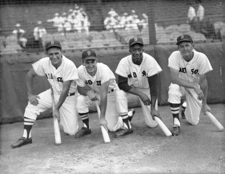 Pumpsie Green, second from right, with Frank Malzone, Don Buddin, and Pete Runnels (left to right) was the first black player to play for the Red Sox in 1959.