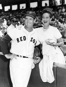 Ted Williams took a moment to pose for a photo with a fan on July 4, 1960.