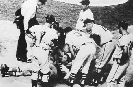 Teammates huddled over Tony Conigliaro after the Red Sox slugger was beaned on on Aug. 17, 1967.