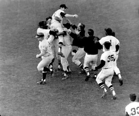 Teammates converged on Jim Lonborg, center, after he led the Red Sox to a win in the 1967 season finale.