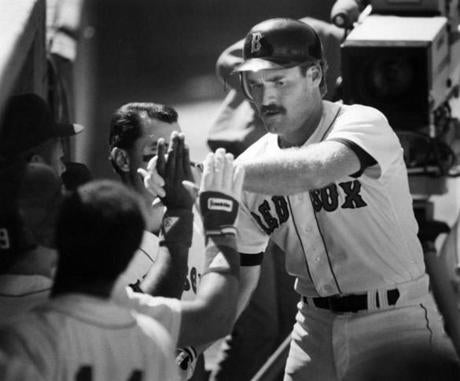 Teammates congratulated Wade Boggs after his home run helped power a win over the Rangers on May 7, 1989.