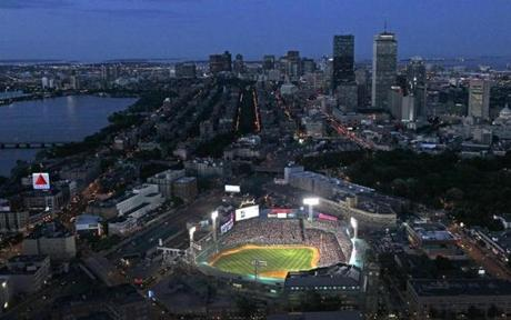 During night games, Fenway Park helps light up Boston.