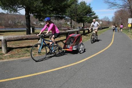 Milford, MA. 03/23/12, Bicyclists on th Milford Upper Charles Trail. Karla Boudreau, cq, of Franklin, and her brother John Romiglio, cq, of Milford, cq, take a ride with their respective sons, Dustin, 3, and Lucas 2, respectively. Section; West Weekly Globe staff/Suzanne Kreiter