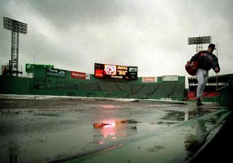 Rain washed away the game on April 21, 2000, and Jason Varitek retreated from Fenway's wet playing field to the dugout.
