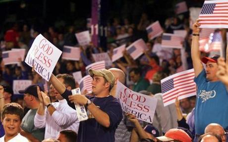 Patriotism dotted Fenway Park as the Red Sox returned from a week-long hiatus after the Sept. 1