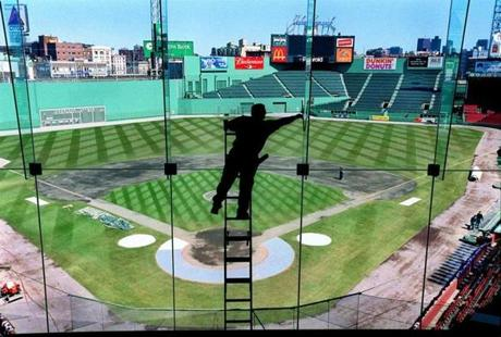 Mike McNealy washed windows in the 600 Club as Fenway Park was prepared for Opening Day in 2001.
