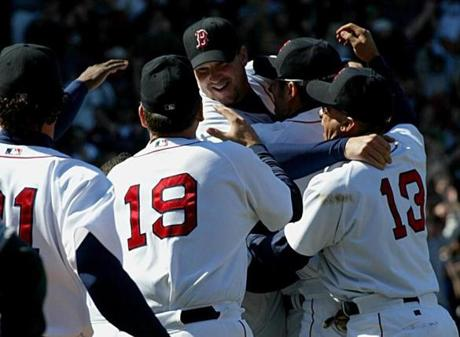 Teammates rejoiced with Derek Lowe, center, after he completed his no-hitter against the Devil Rays on April 27, 2002.