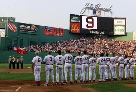 Johnny Pesky, left, led the Red Sox in tribute to his former teammate, Ted Williams, on July 5, 2002, after the slugger's death.