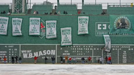 The Red Sox hung the Celtics' championship banners from the left field wall as they honored late Celtics president Red Auerbach on April 12, 2007.