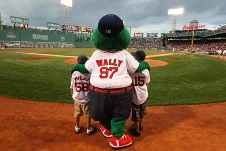 Wally the Green Monster hung out with Weston Taylor, 9, (left) and Mason Taylor 10, of Eagle Mountain, Utah, in 2008. The boys had recently lost their father in a medical helicopter accident.