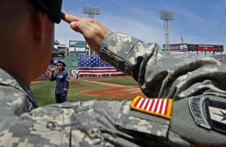 U.S. Army Captain Jesse Bourque saluted during the national anthem on Independence Day 2010 at Fenway Park.