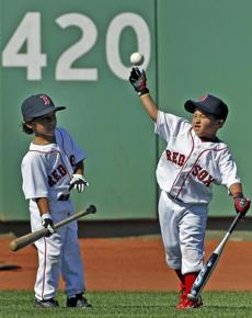 D'Angelo Ortiz (left), son of David Ortiz, and Victor Martinez, son of Red Sox catcher Victor Martinez, patrolled the outfield during batting practice on June 30, 2010.
