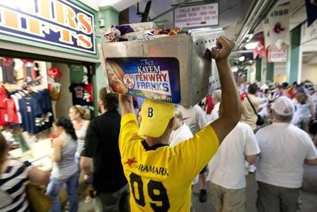 Jose Magrass walked through the concourse while selling Fenway Franks on July 6, 2011.