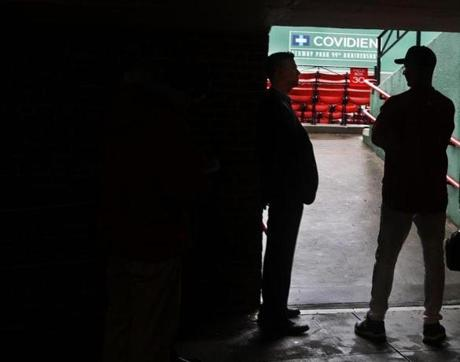GM Theo Epstein, left, huddled with manager Terry Francona inside the bowels of Fenway Park as the Red Sox struggled through a September 2011 slump during which they would squander a record 9 1/2-game lead and miss the playoffs.