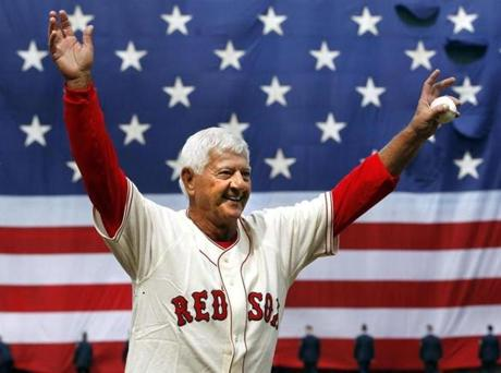 Carl Yastrzemski acknowledged the fans after throwing out the first pitch on Opening Day in 2011.