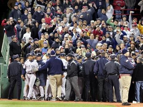 Yankees right fielder Gary Sheffield, left, was led away after an incident with a fan on April 14, 2005.