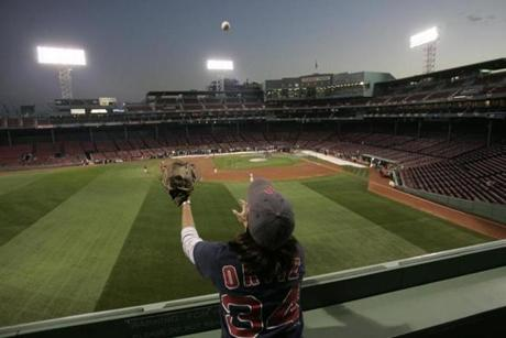 Laura Moberg reached for a ball thrown up to her by Red Sox catcher Doug Mirabelli before a 2007 game.