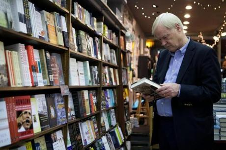 "Chris Matthews, author of ""Jack Kennedy,"" browses for books after speaking at an author appearance event at the Brookline Booksmith."