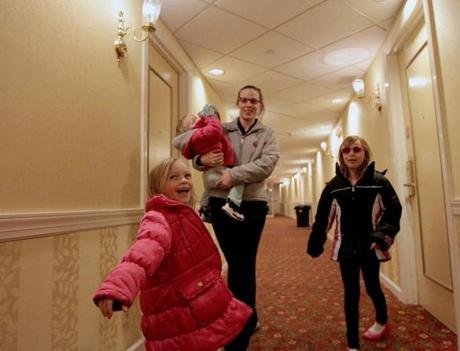 Nicole Sheck and her daughters Angela Tilton-Sheck, 4 (left), Nevaeh Braun, 1 (in her arms), and Adrianna Sheck, 8, left the hotel to go look at an apartment.