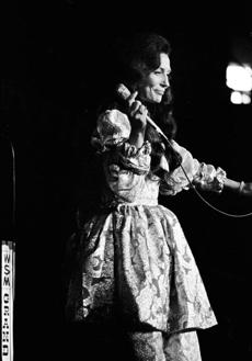 Loretta Lynn onstage at the Grand Ole Opry in 1972.