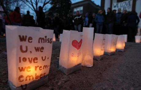 Bags marked with tributes were illuminated by candles at a vigil at the school.
