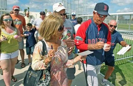 Valentine, who moves quickly even at age 61, signed autographs, saying