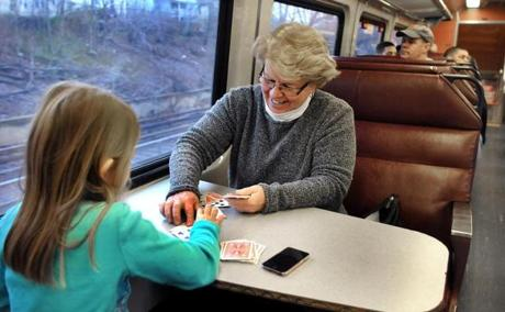 Maryann Hughes of Falmouth played cards with her granddaughter, Kasey Boettger. They take the commuter rail to Boston for a once-a-month outing.