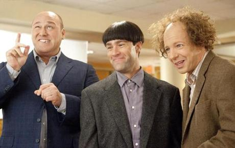 "From left: Will Sasso (Curly), Chris Diamantopoulos (Moe), and Sean Hayes (Larry) bring the classic comedy trio back in the Farrelly brothers' ""The Three Stooges."""