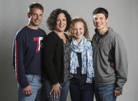 Julia Ruff, 14, with her family