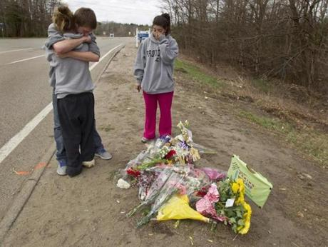 Summer Anderson, 16, hugged friend, Jason Beausolei, 16, as D'Angela Alberty looked on at the scene of the fatal car crash that took the live of Michaela Smith. April 8, 2012.
