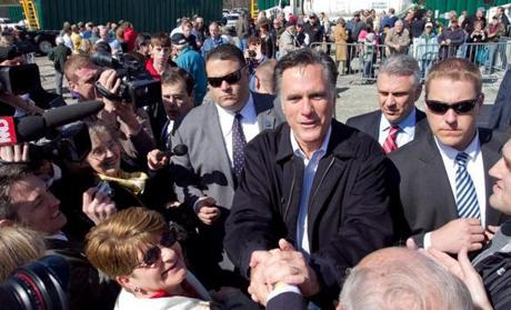 Mitt Romney has spent heavily to quash a challenge from Republican rival Rick Santorum.