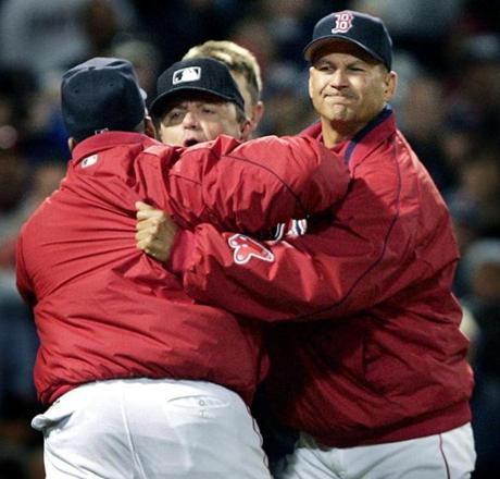 Red Sox hitting coach Ron Jackson had to be held back from getting to home plate umpire Greg Gibson, (rear).