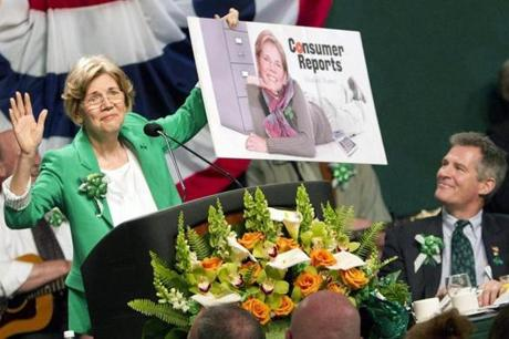Elizabeth Warren poked fun at campaign rival Scott Brown's appearance in a Cosmopolitan centerfold at the 2012 breakfast.